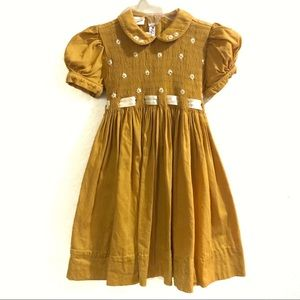 Pervenche hand embroidered smocked mustard dress